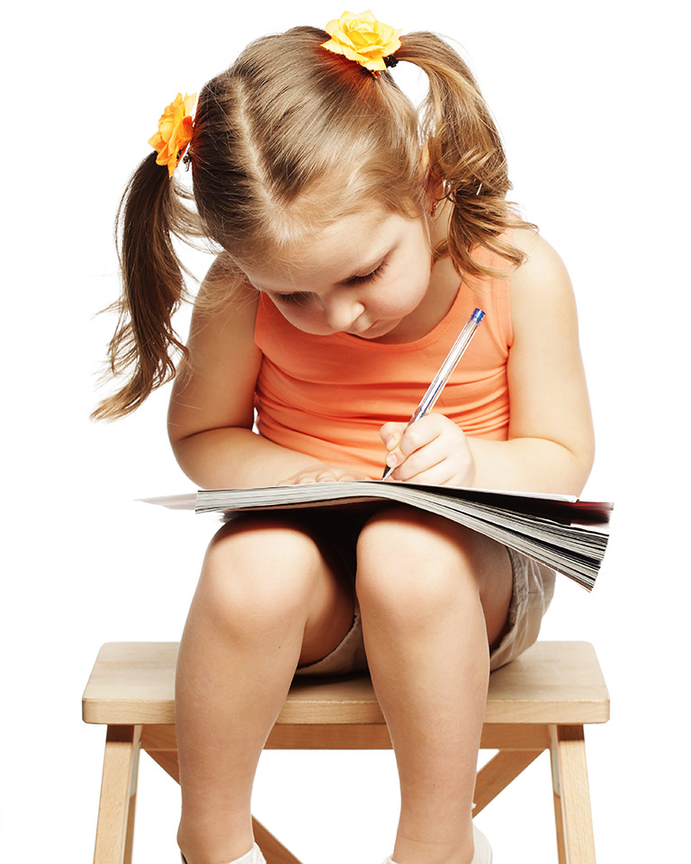 little girl taking a test