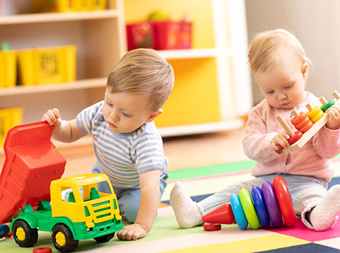 boy and girl toddlers playing