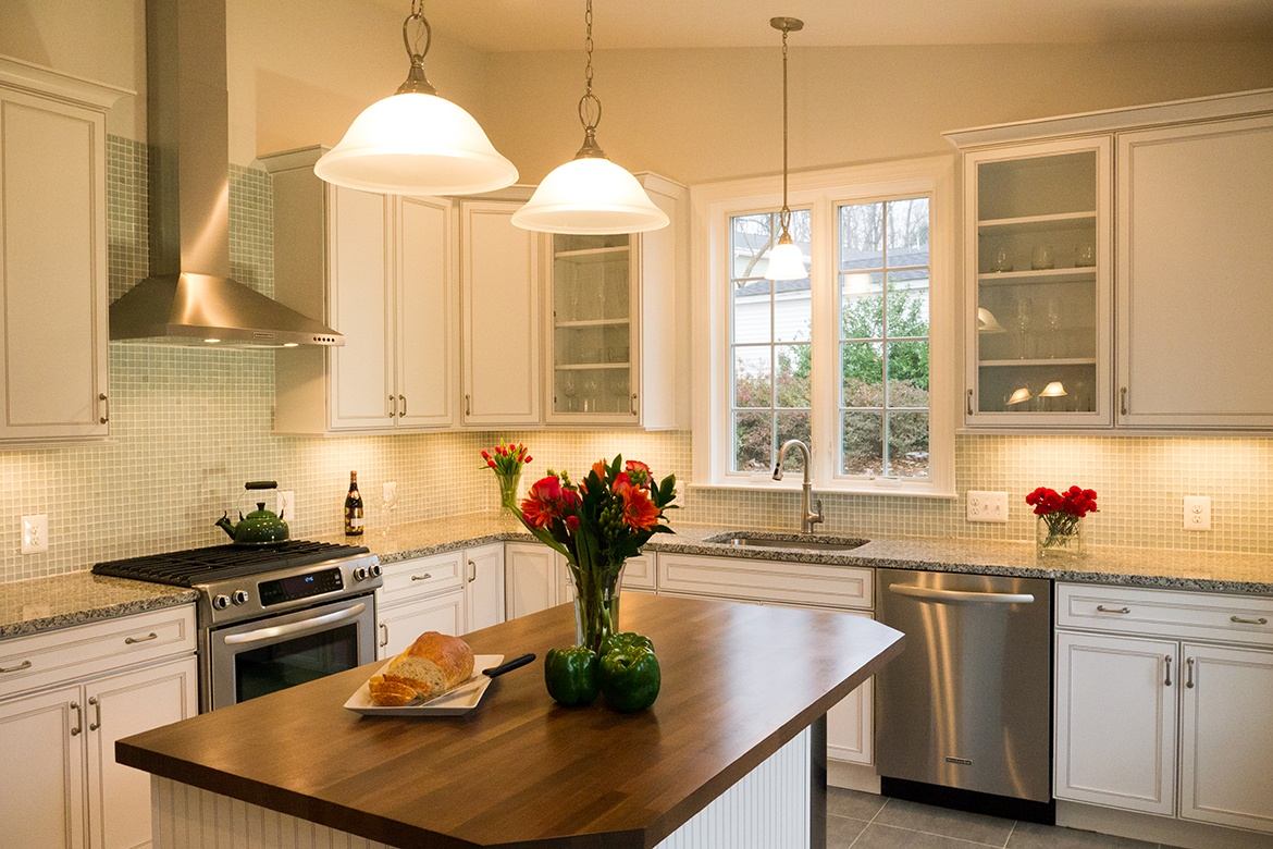 Kitchen remodel in Northern Virginia, white cabinets, stainless steel appliances, tile backsplash, island, french doors