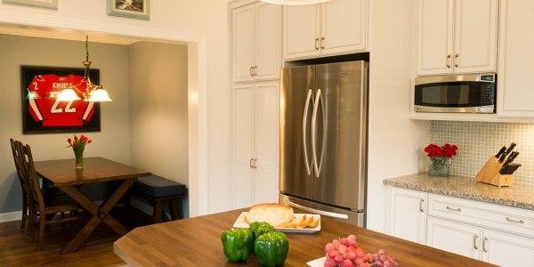 Kitchen remodel in Northern Virginia, white cabinets, stainless steel appliances, tile backsplash, island, eating nook