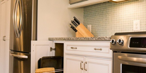 Kitchen remodel in Northern Virginia, white cabinets, stainless steel appliances, tile backsplash, island, pull-out storage