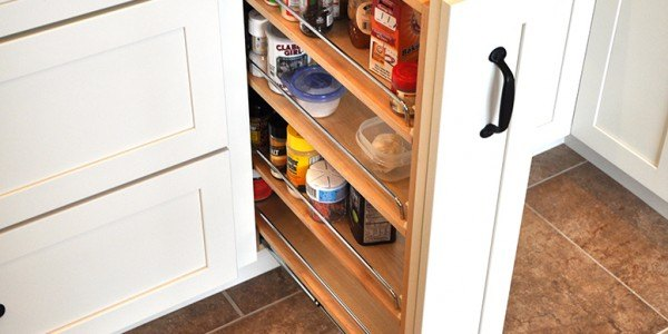 Kitchen remodeling in Northern Virginia, Maryland, & Washington, DC; eat-in kitchen; white cabinets; stainless steel appliances; pull-out spice rack