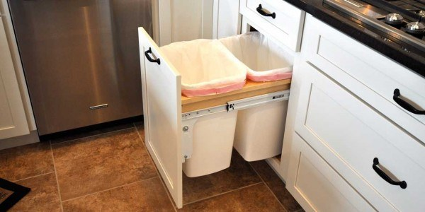 Kitchen remodeling in Northern Virginia, Maryland, & Washington, DC; eat-in kitchen; white cabinets; stainless steel appliances; double trash bin drawer