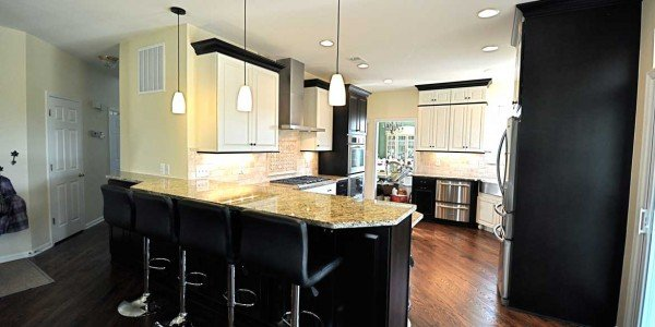 Kitchen remodeling in Northern Virginia, Maryland, & Washington, DC; eat-in kitchen; white and black cabinets; stainless steel appliances;