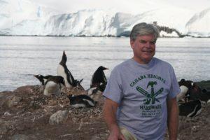 James B. McClintock with Gentoo penguins on the Antarctic Peninsula - January 2017
