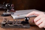 hand-tapping-morse-code-on-an-antique-telegraph-machine