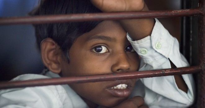 Boy in a train wagon, Delhi India