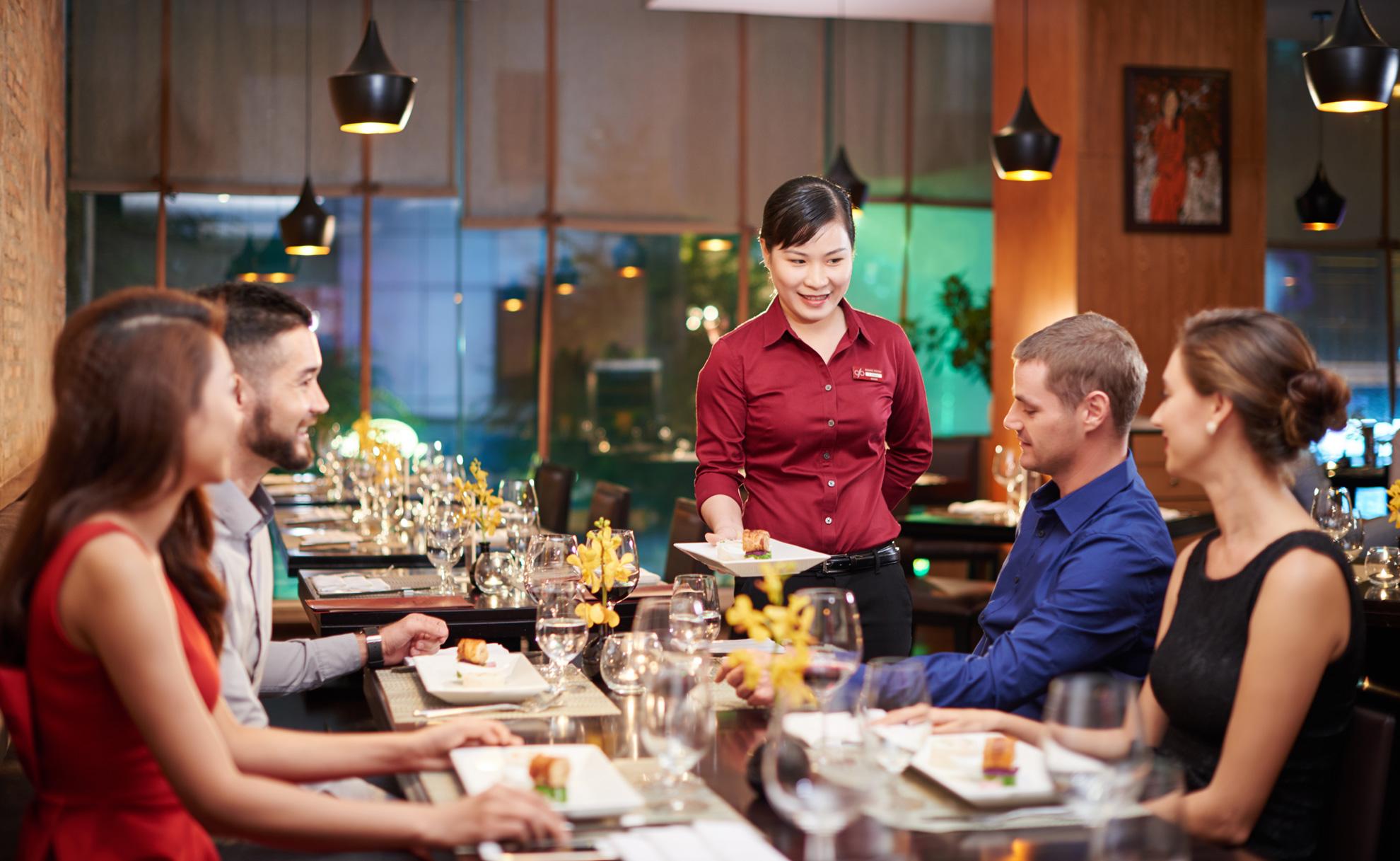 Waitress are serving food to customesa at Dining Room Restaurant Ho Chi Minh