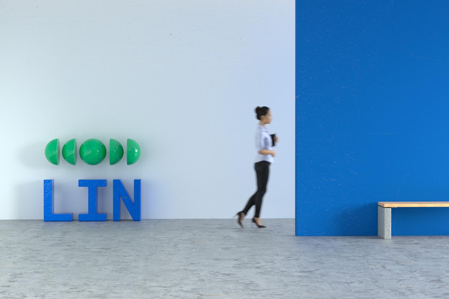 A women is walking in office space with LIN logo