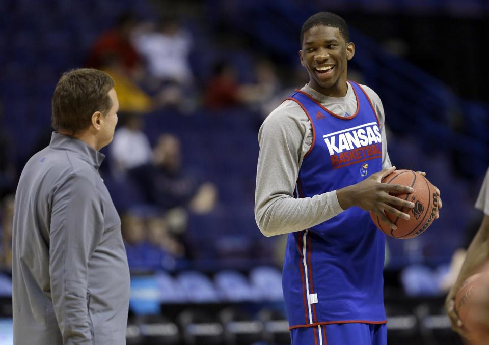 Kansas' Joel Embiid, right, talks with head coach Bill Self during practice for the NCAA college basketball tournament Thursday, March 20, 2014, in St. Louis. Kansas is scheduled to play Eastern Kentucky in a second-round game on Friday. (AP Photo/Jeff Roberson)