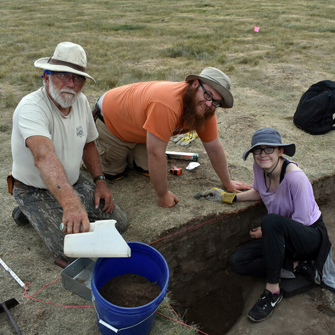 Volunteers excavating a pit feature. Courtesy of Stephen Perkins.