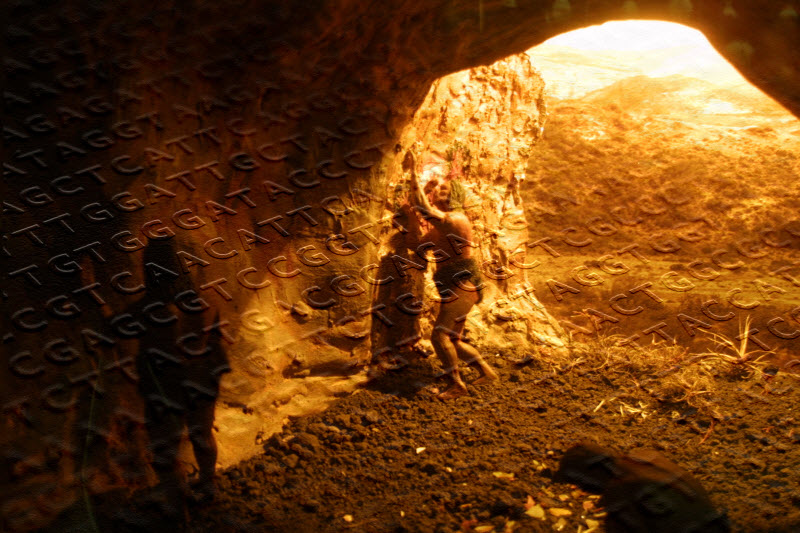 Cave with caveman carving on the wall, superimposed by genetic strings