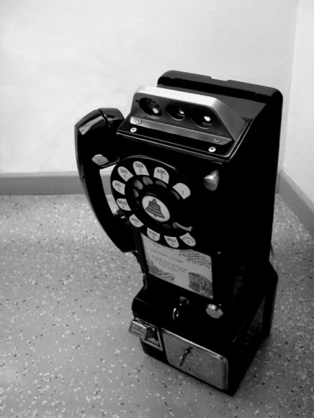 Old-fashioned rotary pay phone