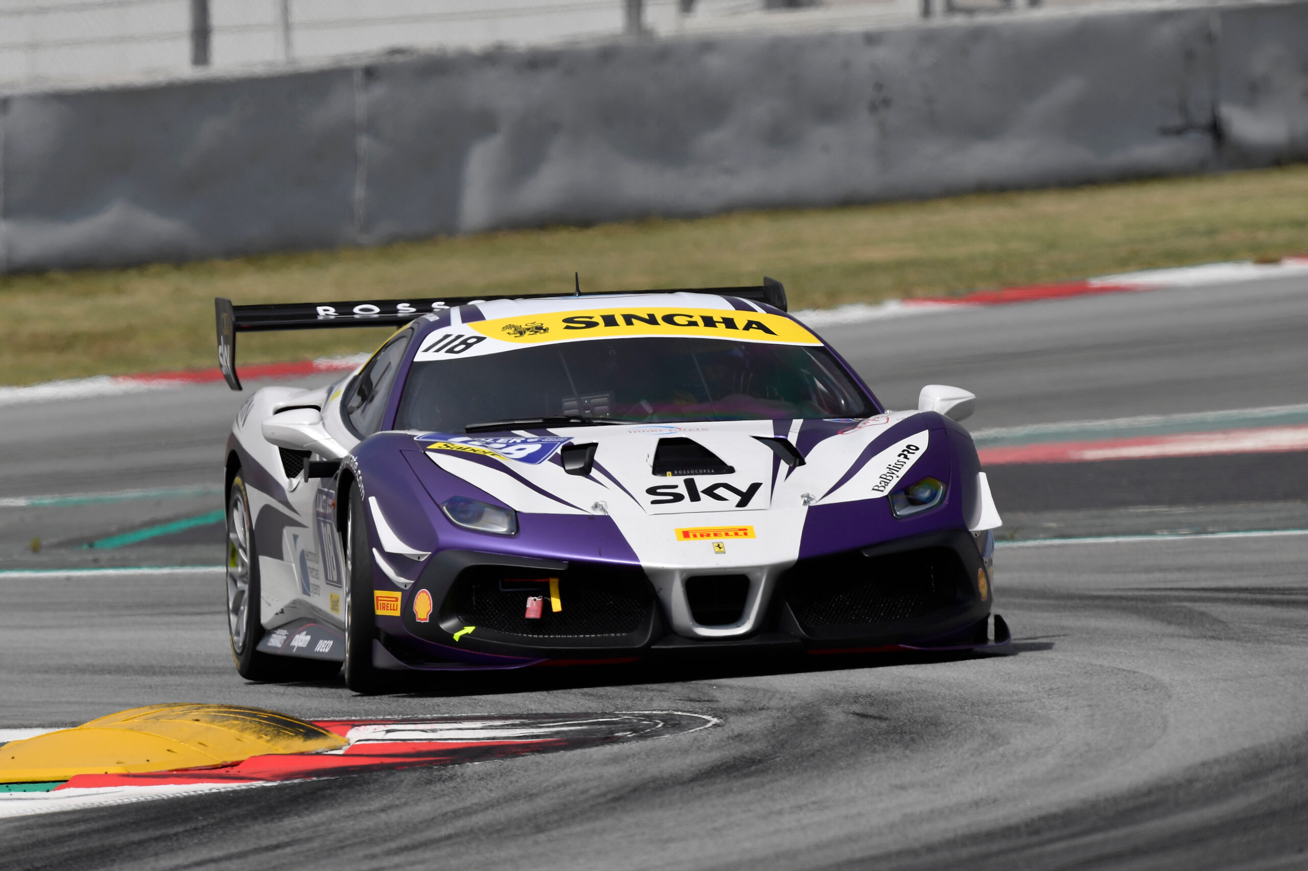 Electronic Merchant Systems Race Team Driver James Weiland finishing P1 in Barcelona Ferrari Challenge