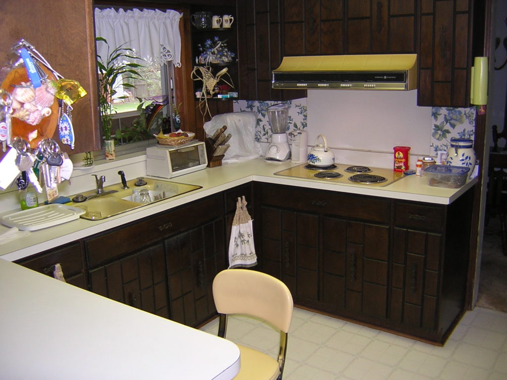 Old fashioned colored countertop and cabinetry BEFORE resurfacing