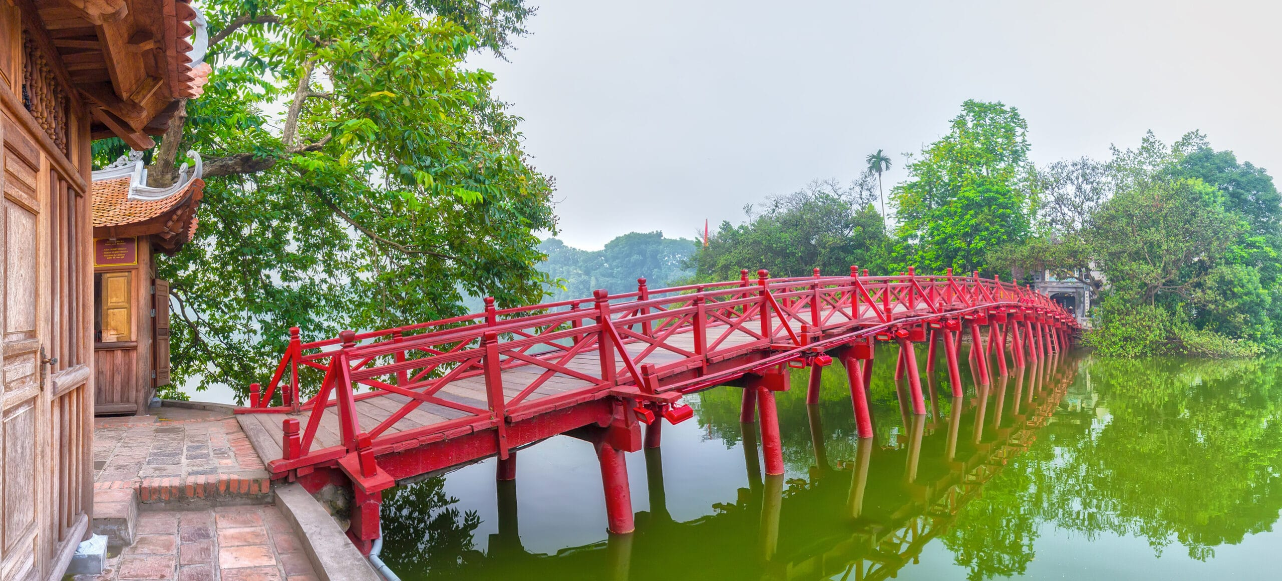 Huc Bridge spanning the Ngoc Son Temple, Hanoi, Vietnam with curved bridge architecture crawfish red symbolizes capital region thousands of years civilization, god temple tortoises enters Vietnam history