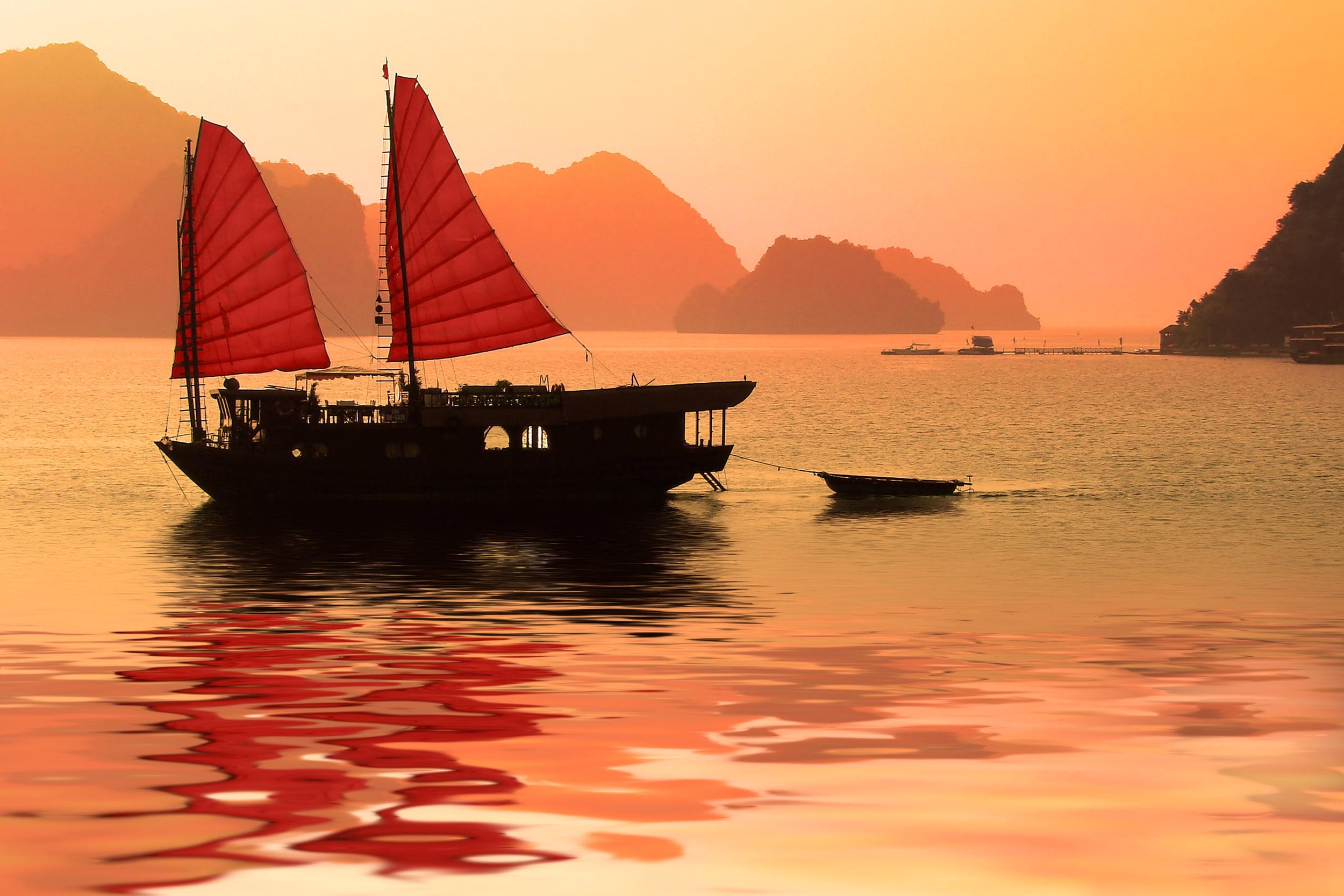 Junk boat at sunset in Halong Bay, Vietnam