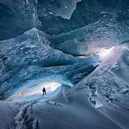 Man standing in Ice Cave in Iceland