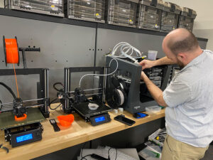 A Billings Flying Service engineer calibrates one of the several 3D printers tasked with printing masks that will assist first responders. Billings Flying Service image