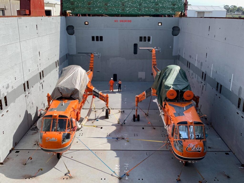 "Erickson Air Cranes ""Elsie"" and ""Delilah"" are prepped for shipping to Greece after their season in Australia. Erickson Air Crane image."