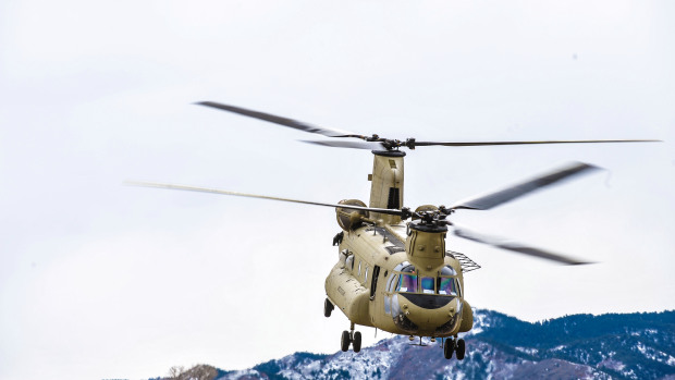Black Hawk, Chinook Helicopters Conduct 'Water Bucket' Training At Chatfield Reservoir