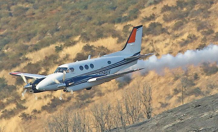 Pilot planes lead the way in aerial firefighting
