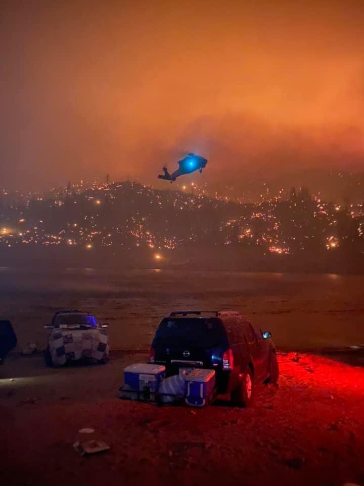 A UH-60 was the second aircraft of a flight of two rescue helicopters sent to retrieve several hundred stranded campers at Mammoth Pools Reservoir that was cut off by the Creek Fire.
