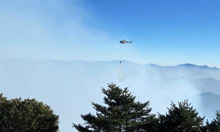Simrik Air helicopter conducts fire-fighting mission at Pathivara Temple Area