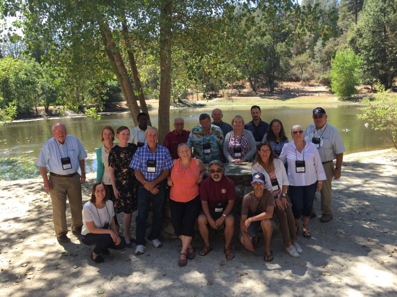 RCD Directors standing in front of a small lake in Oakhurst, CA