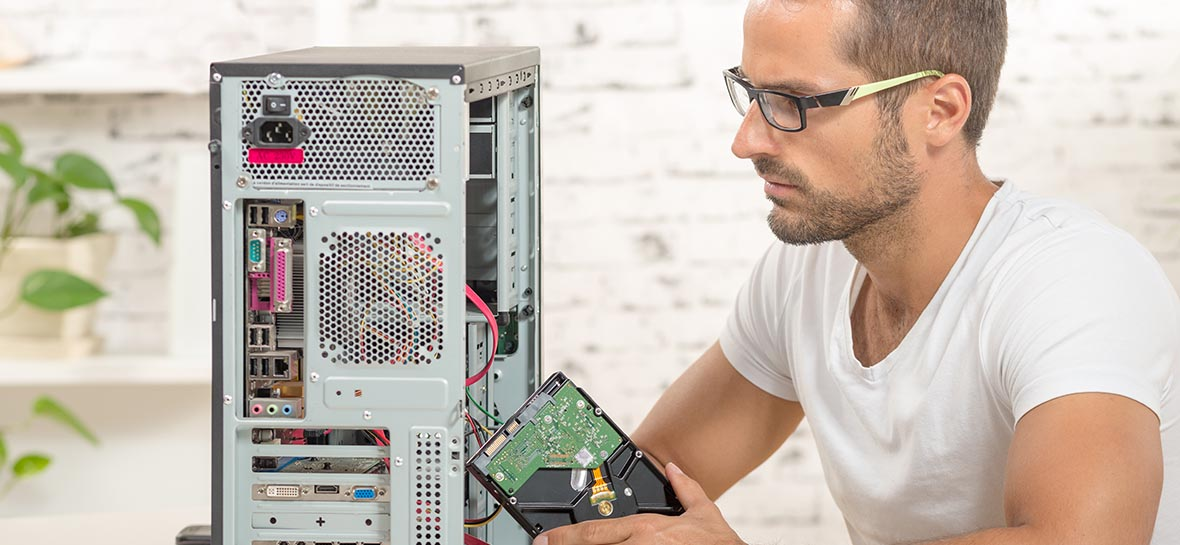 young engineer repaired a computer with a new hard disk
