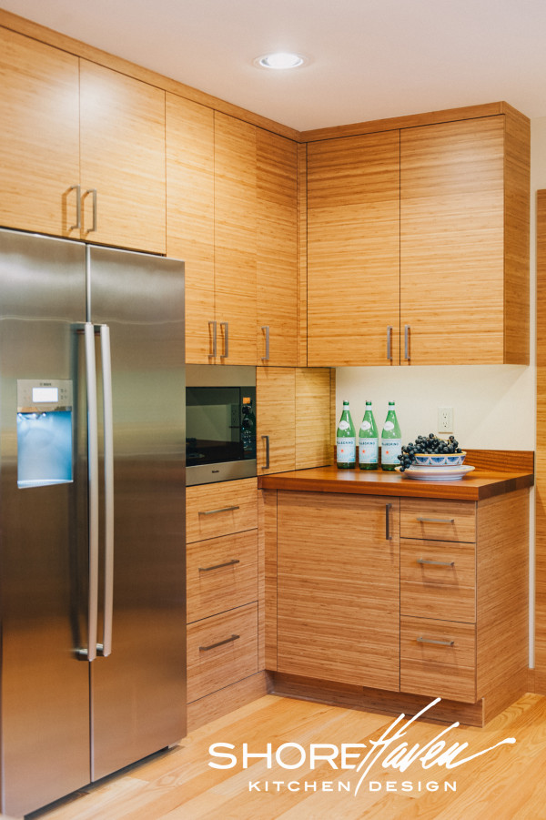 Bamboo Pantry Cabinets Frame Refrigerator and Built-In Microwave.