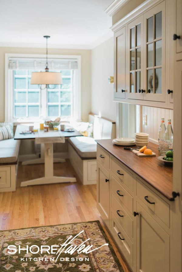 Butler's pantry and banquette nook offer the perfect transitional space from kitchen to living area.
