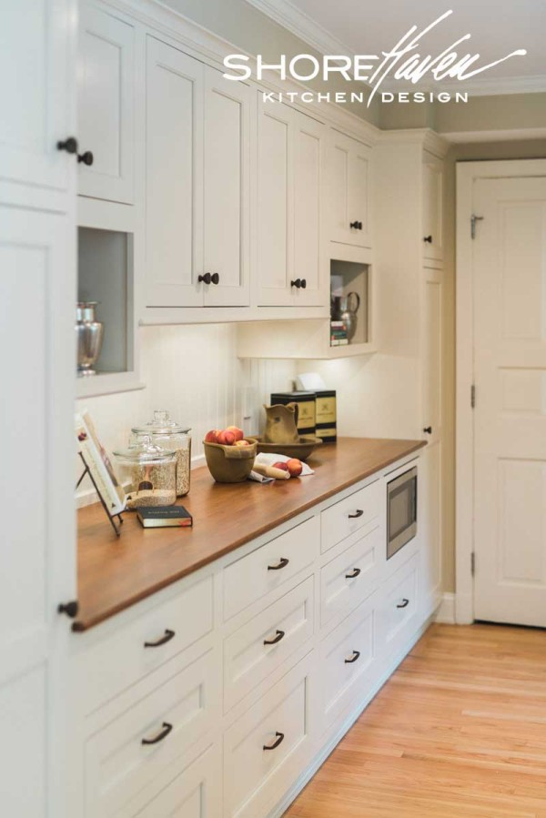 Cherry counters add warmth to the built-in baker's wall.