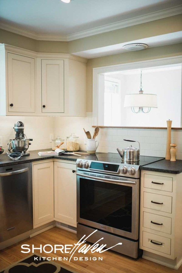 Matching matte antique white subway tile backsplash, seamlessly transitions from wall cabinets to base.