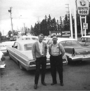 Granddad and dad on car lot