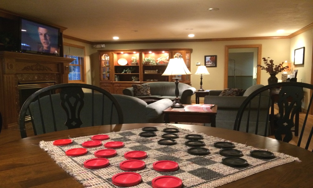 One more angle of our beautiful northern door county hotel lobby, with a game of checkers set up ready to play!