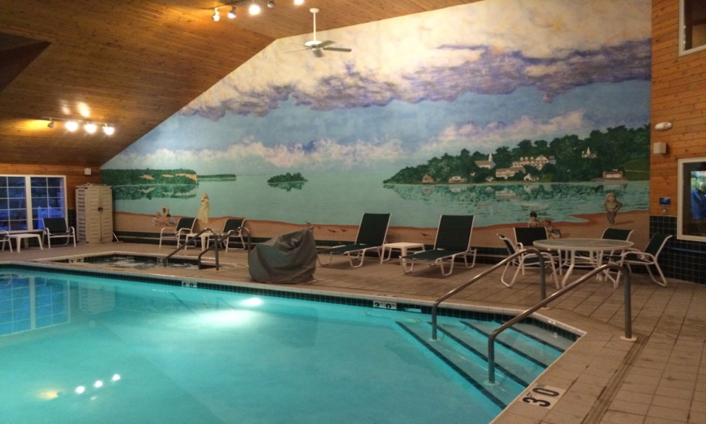 Enjoy a swim or hang out in the hot tub and check out our mural of the beach in town.
