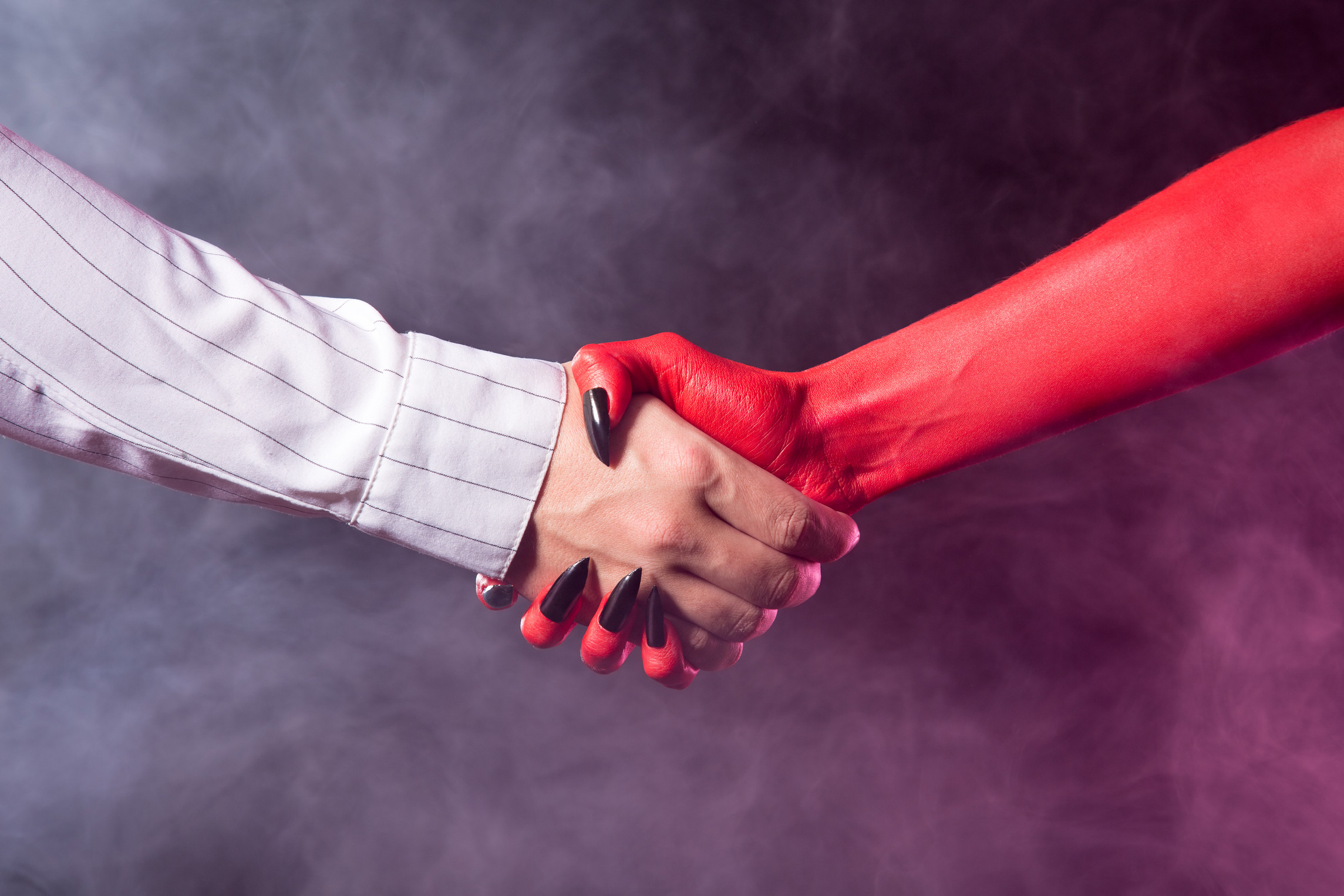 deal with the devil handshake