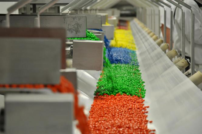 Colorful candy manufacturing photo. Article highlights news about manufacturing in the U.S.