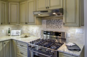 Kitchen remodel, tile, stainless steel gas range.