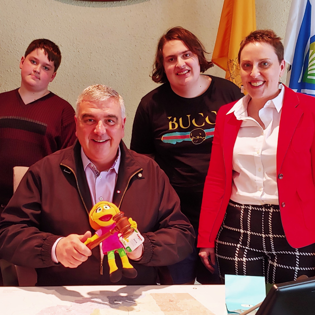 "Wanda and her boys giving ""Julia from Sesame Street"" to the Mayor of Waterloo to celebrate Autism Awareness/Acceptance month."