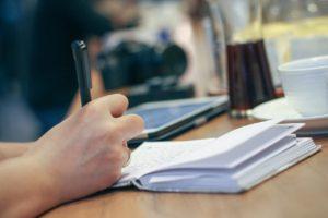 writing in a café