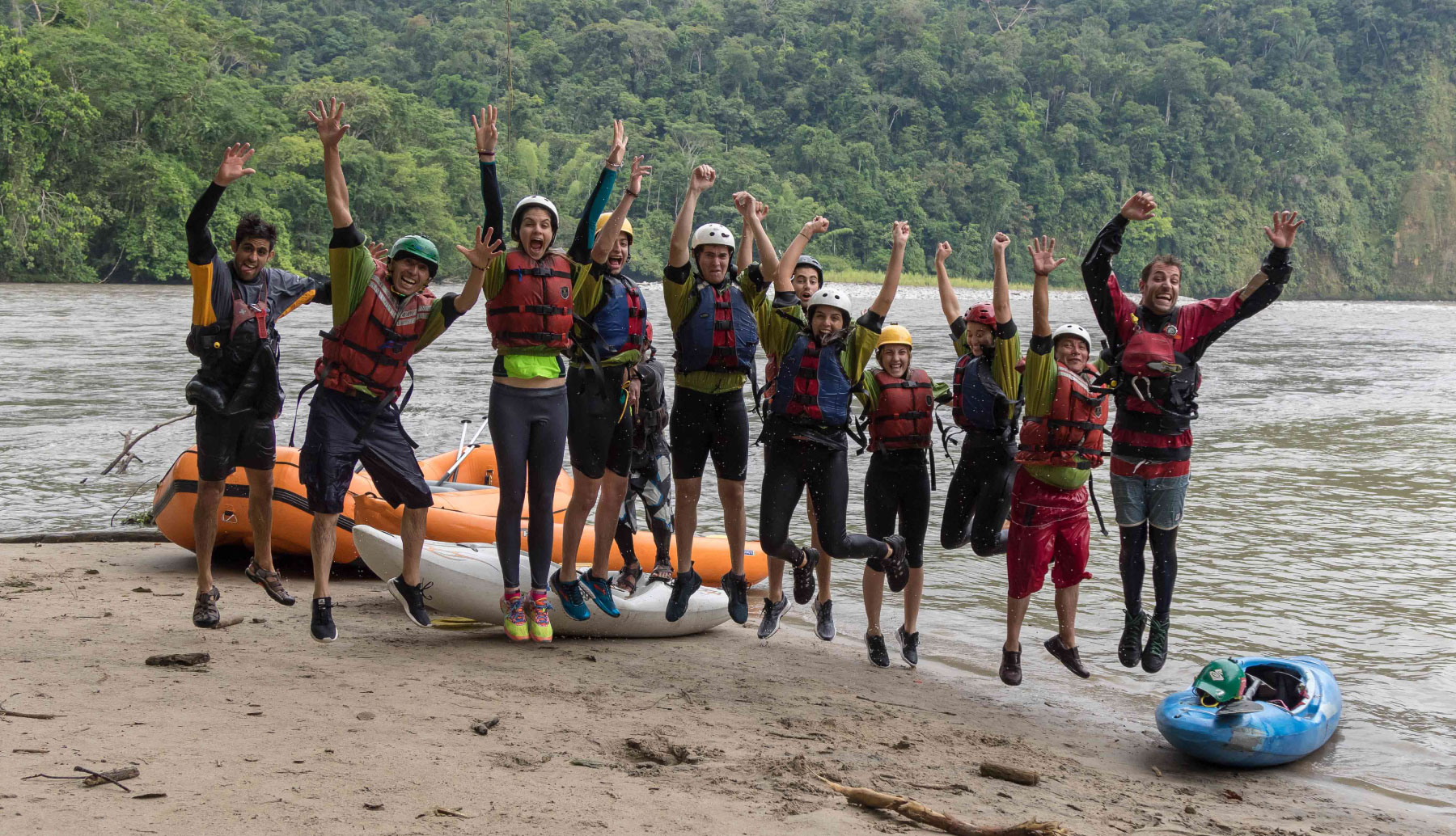 People jumping after a rafting trip in jungle in Southamerica