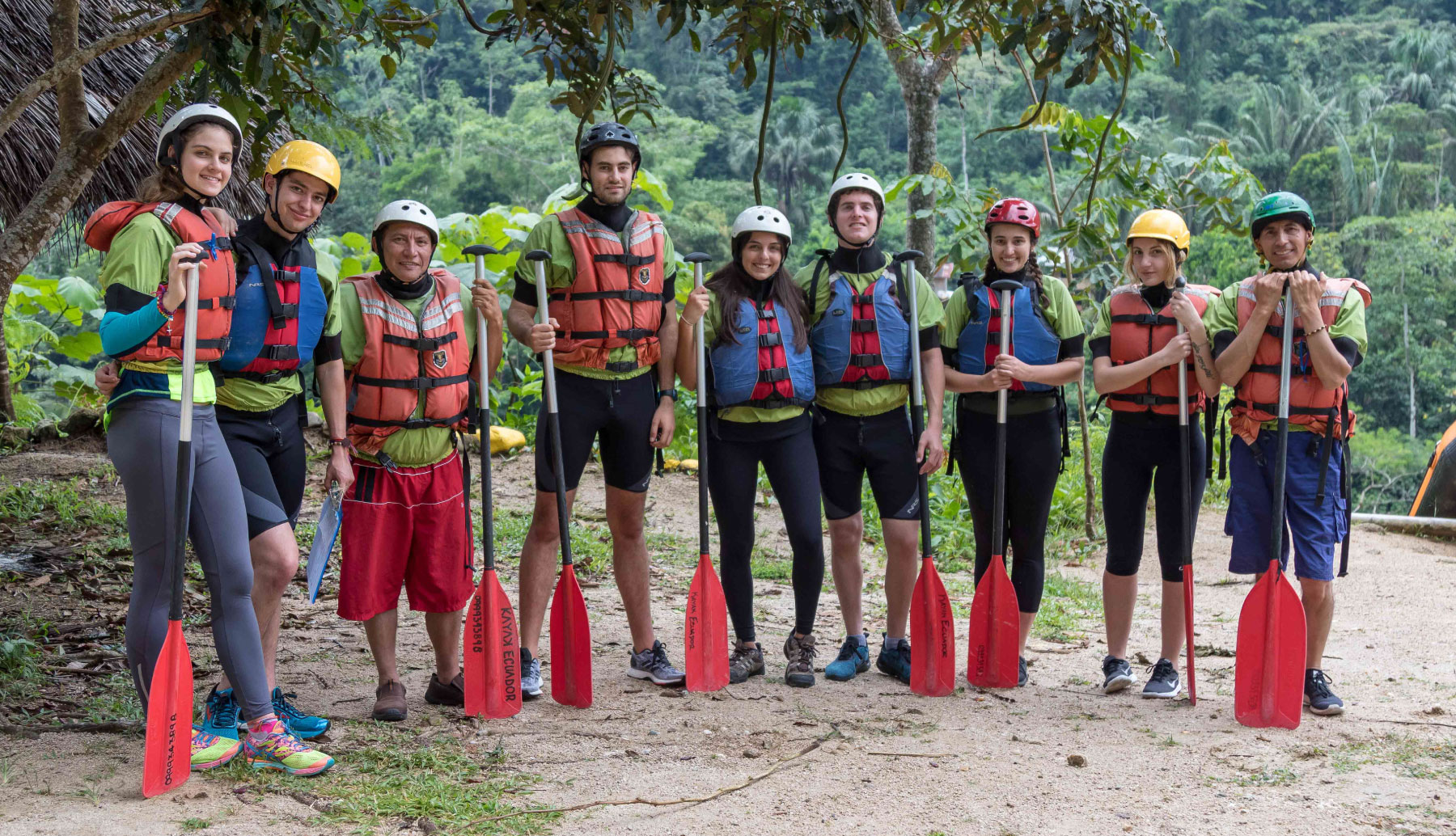 People with rafting paddles ready to do rafting