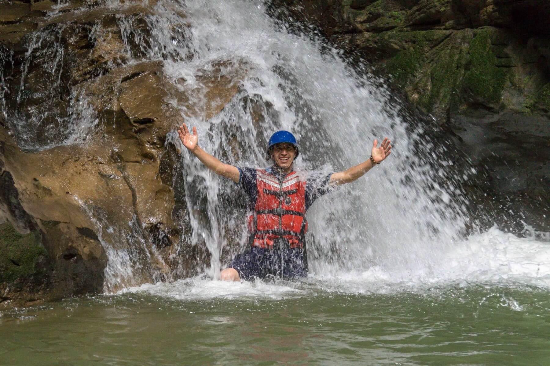 Man in a waterfall in Gran Cañon of Jondachi river