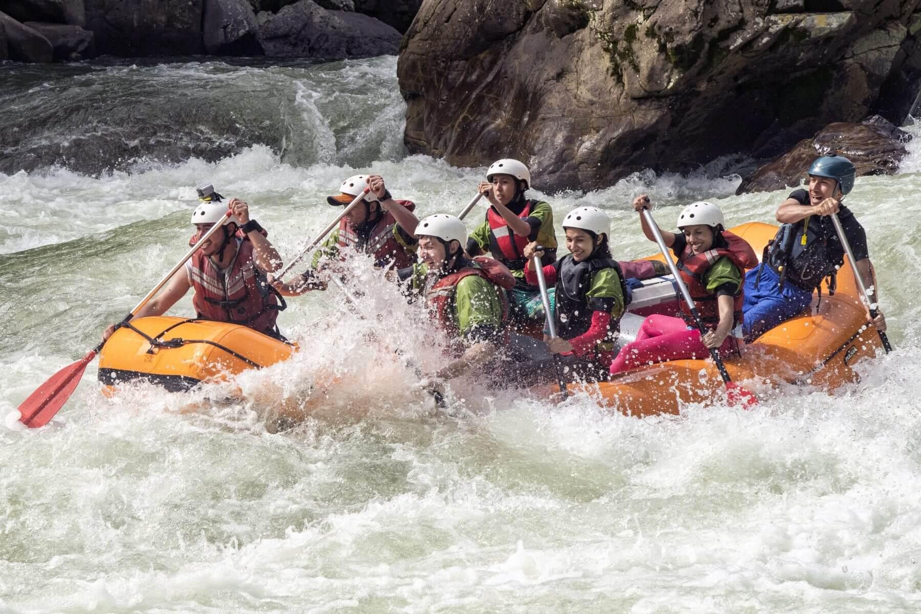 Smiling faces, in a rafting boat in Jondachi river in Tena, Napo.