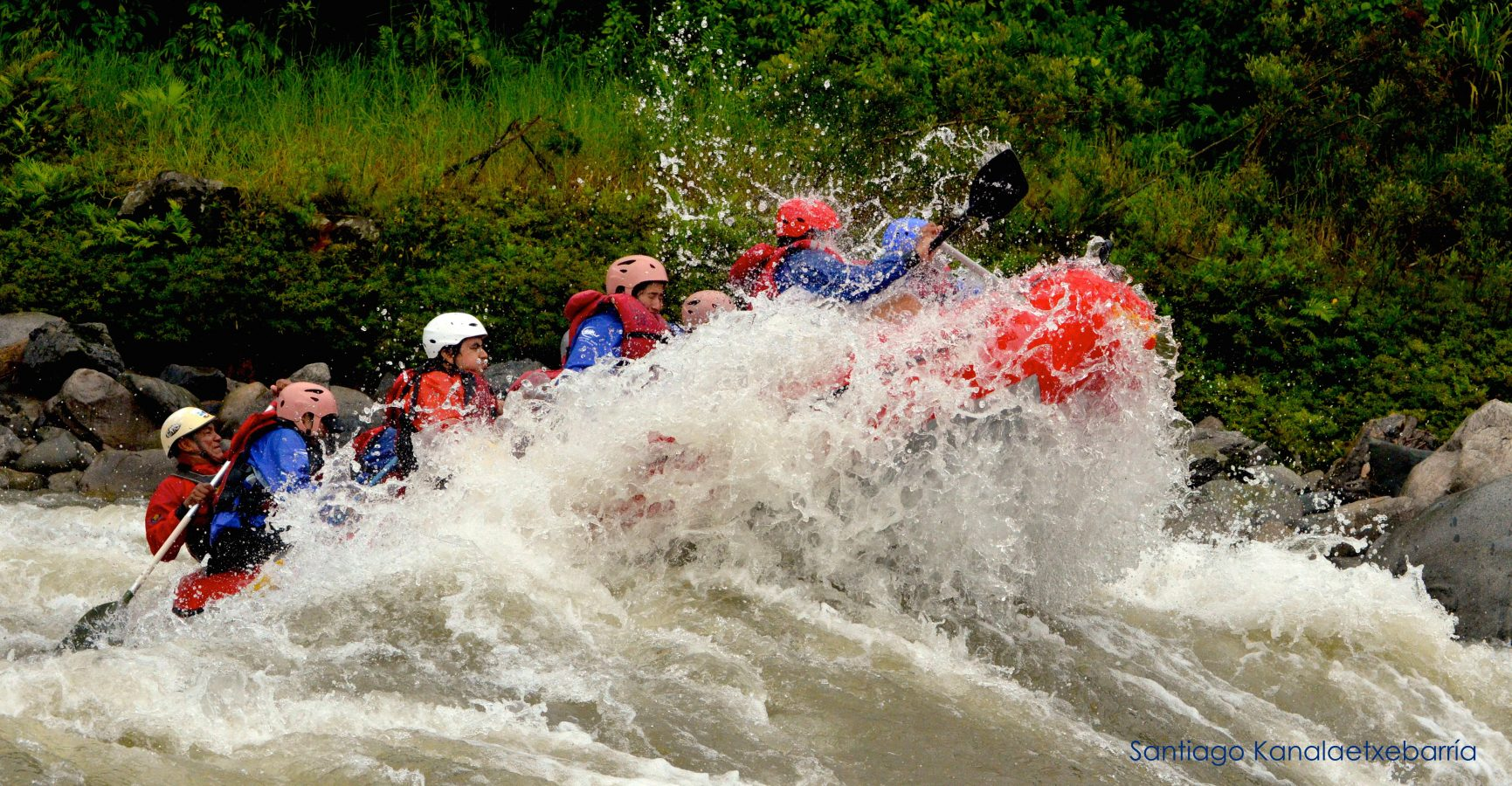 Rafting boat in the middle of a big wave