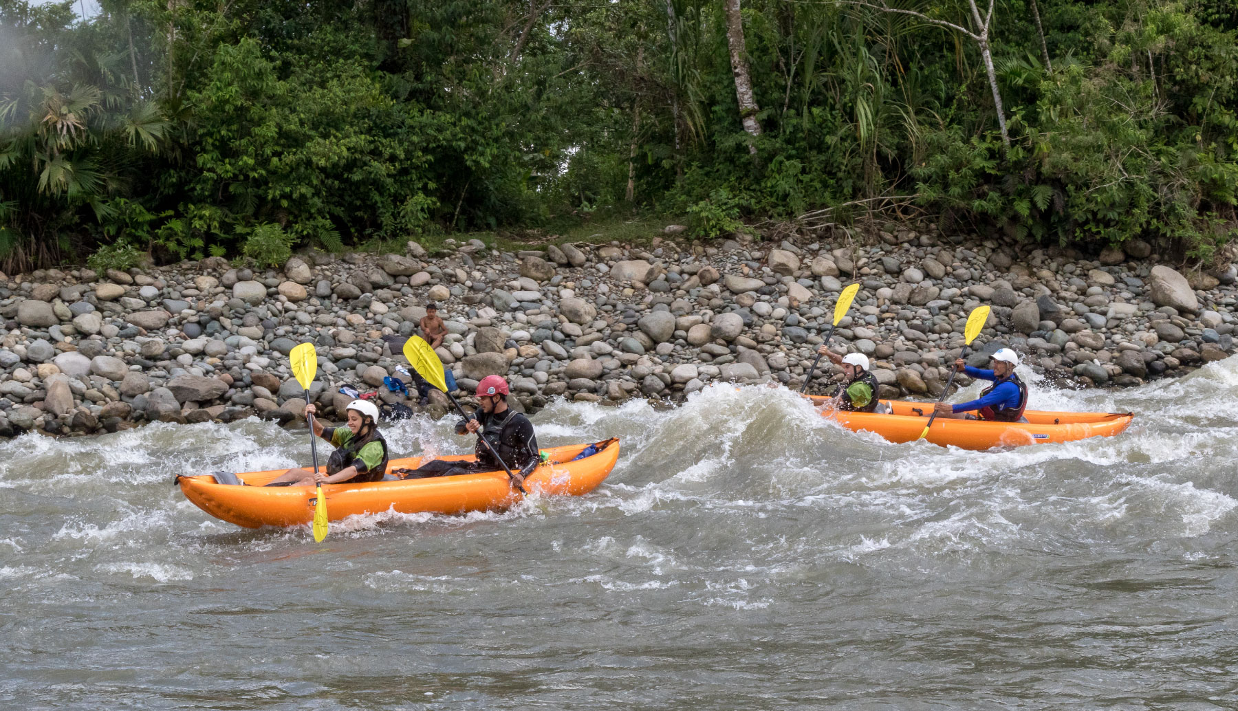 Two duckies in Jatunyacu river enjoying the trip