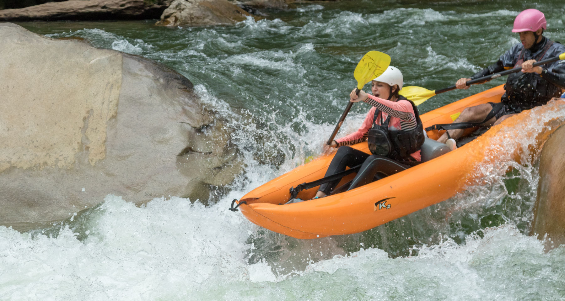 Girl kayaking in a duckie in Jatunyacu river