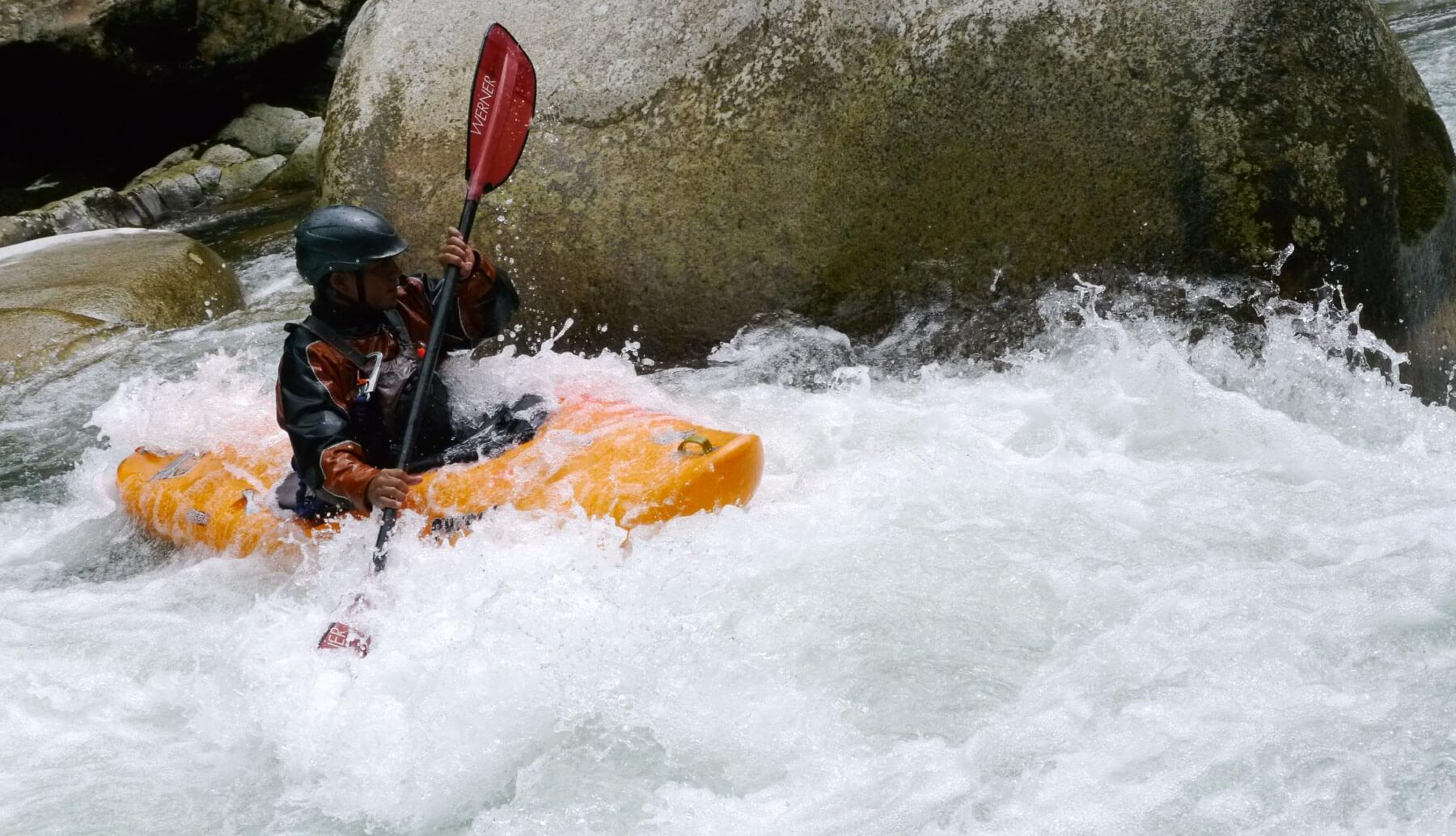 Kayaker maneuvering rapids in Ecuador
